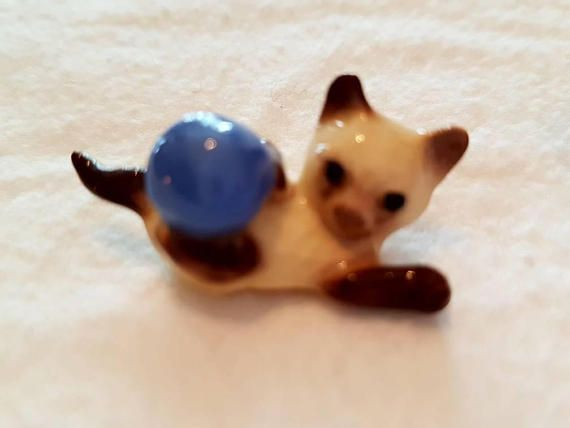 Check out this item in my Etsy shop https://www.etsy.com/ca/listing/582821298/miniature-porcelain-siamese-cat-with