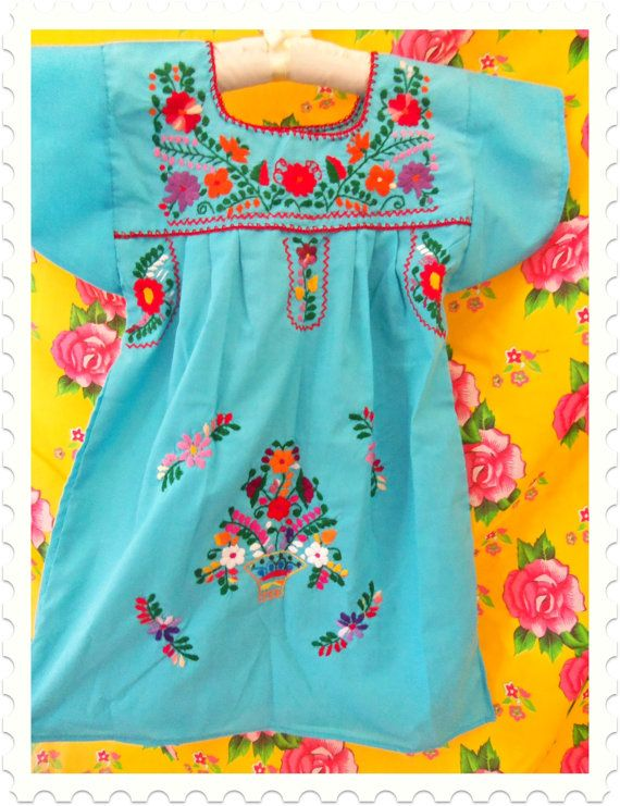 Embroidered Mexican baby dresses. Love everything about this!