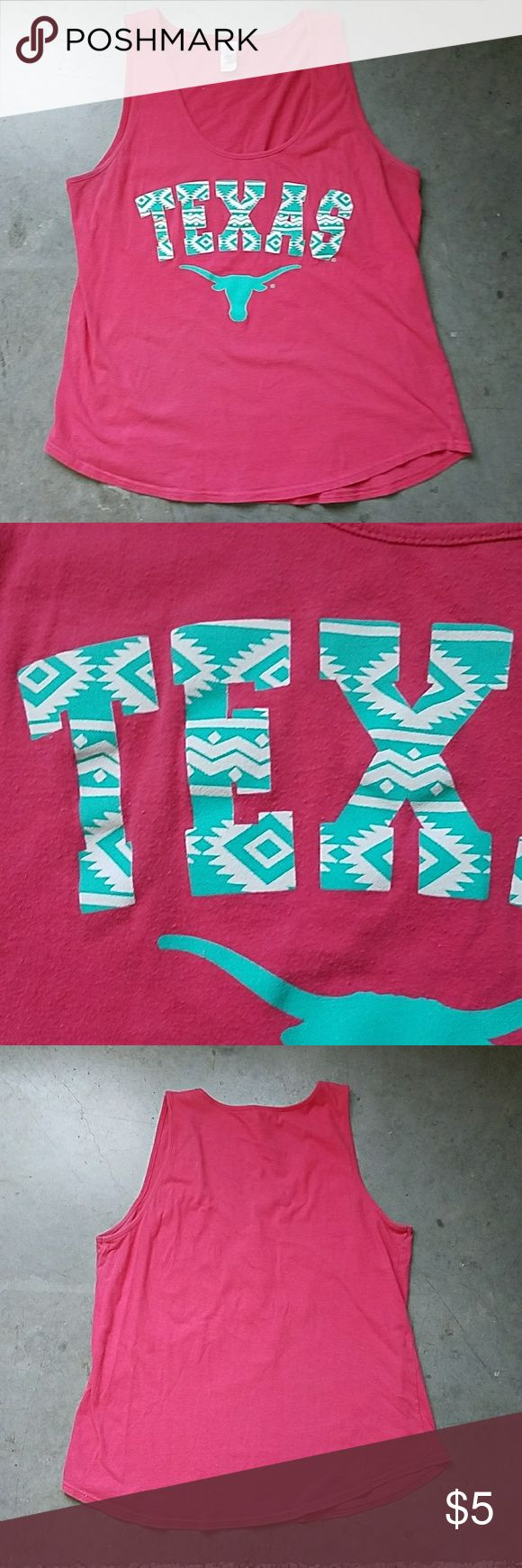 Texas Longhorn Pink Tank This super comfortable tank is 100% cotton with a flattering rounded hem. Support the Longhorns or rep Texas with fun Aztec print text and solid teal Longhorn. Willing to negotiate price. UT Austin Co-Op Tops Tank Tops