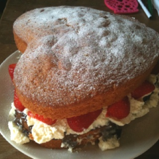 Heart shaped victoria sponge with violet jam,whipped cream & strawberries