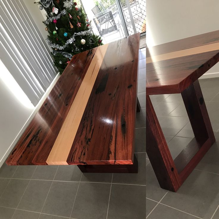 Dining table made from reclaimed Jarrah pier posts