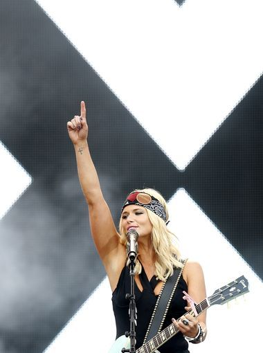 Miranda Lambert entertains the crowd at Papa John's in Understated Leather patched bandana