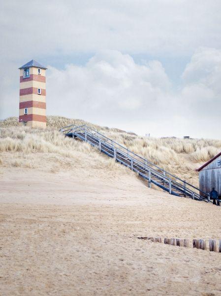 lighthouse on dutch beach in zeeland..