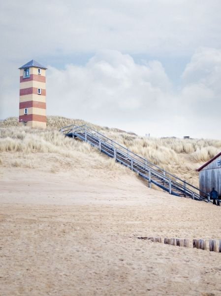 lighthouse on dutch beach in zeeland..