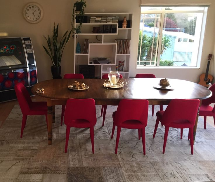 This neutral patchwork rug makes a great platform for the dining table & chairs above.