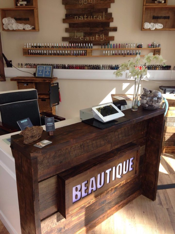 Upcycled reception desk using pallets and scaffold boards for Salon workspace