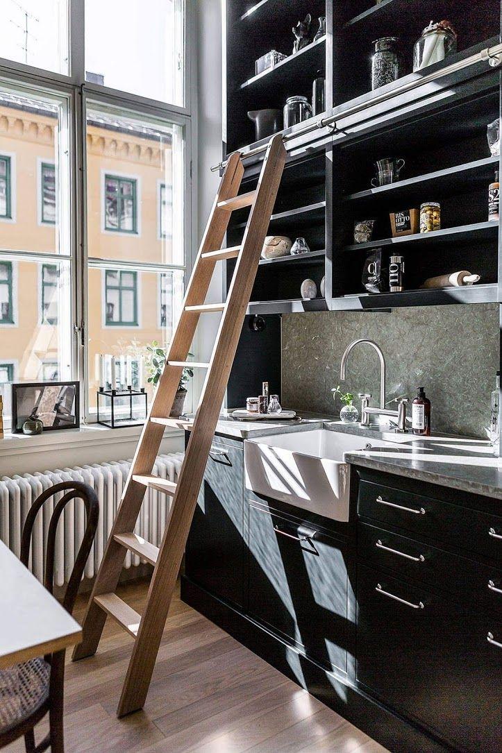 Kitchen sink, ladder, airy windows, black and chrome finishes #kitchen #decor #interiors