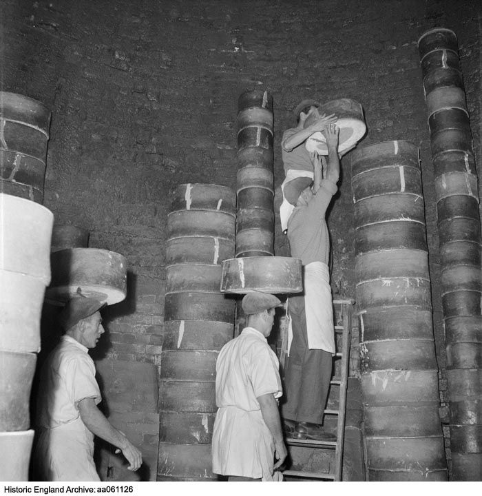 AA061126 Interior view inside a traditional Staffordshire bottle kiln or oven showing men setting saggars containing pottery-wares in preparation for firing. Location unknown, but possibly Stoke on Trent.  Please click the image for more information or to search our collections further.