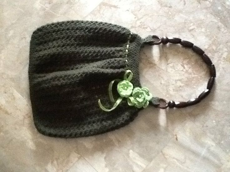 Crochet bag in dark-green decorated with flower and cord in light-green