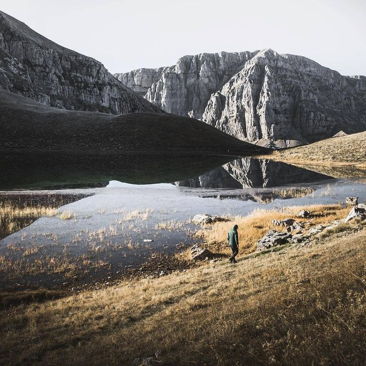 Visit Greece | Rumor has it that Dragons living at Timfi and Smolika Dragon Lakes used to throw rocks when they got mad at each other. This explains why you'll find mostly black rocks at Tymfi and white rocks at Smolika.  #VisitGreece #Greece #Epirus #dragonlake  📸@frithjof.hamacher