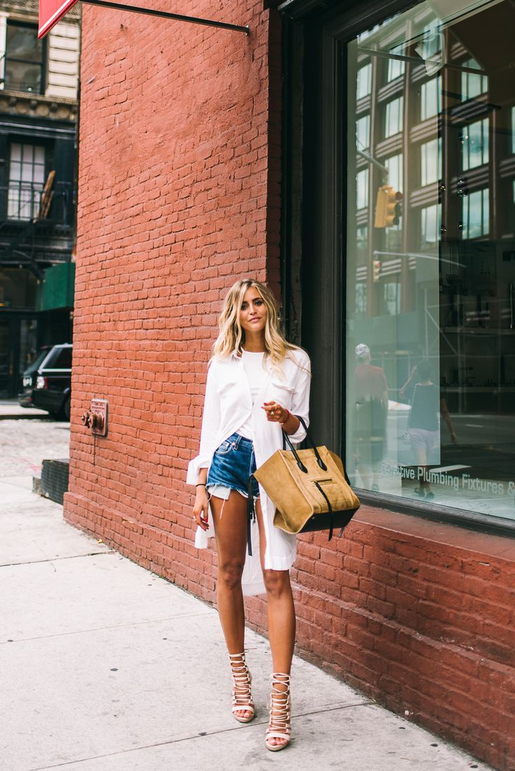 long white button down with cut off jean shorts and laced up heels | Jannie Deler