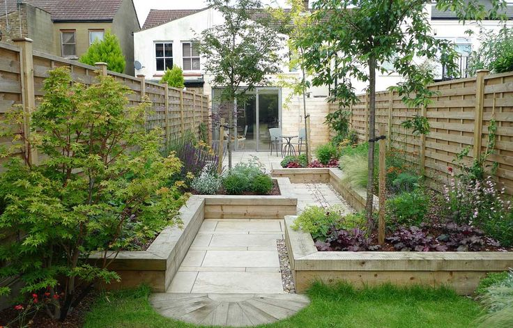 Ravishing Small Garden Design with Winding Path and Natural Wooden Fence as Garden Path Idea