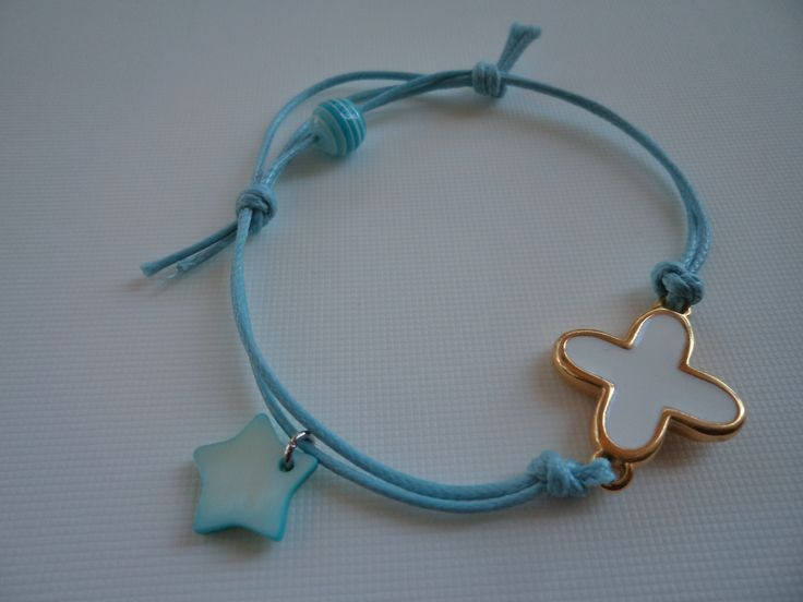 Turquoise wax cord bracelet with a cross and a star.