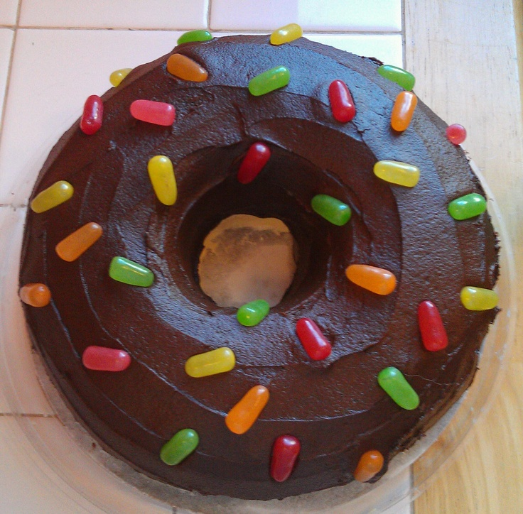 """Giant """"Chocolate Glazed donut"""" cake for Police Academy graduation. Yellow cake baked in ~ 7in diameter ring mold pan, frosted with buttercream and chocolate buttercream and """"sprinkled"""" with Mike & Ike candies!"""