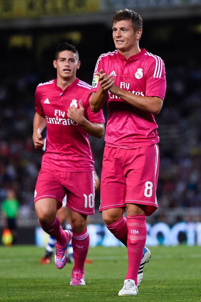 James Rodriguez (L) and Toni Kroos of Real Madrid CF look on during the La Liga match between Real Sociedad de Futbol and Real Madrid CF at Estadio Anoeta on August 31, 2014 in San Sebastian, Spain.