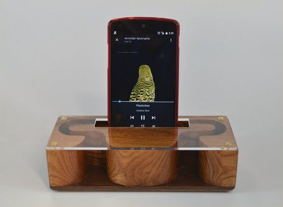 This passive amplifier is made from oak. And it features a clear acrylic top which allows you to see the inner design and a contrasting walnut base.  The 3.75 by .75 cradle opening will accommodate most phones with or without a case.  The amplifier is a compact 7 x 2.75 x 1.5 tall, but has some weight to it. This prevents it from tipping over backwards when operating the phone.  The amplifier works by re-directing the sound for your phones speakers towards you. No batteries or cables…