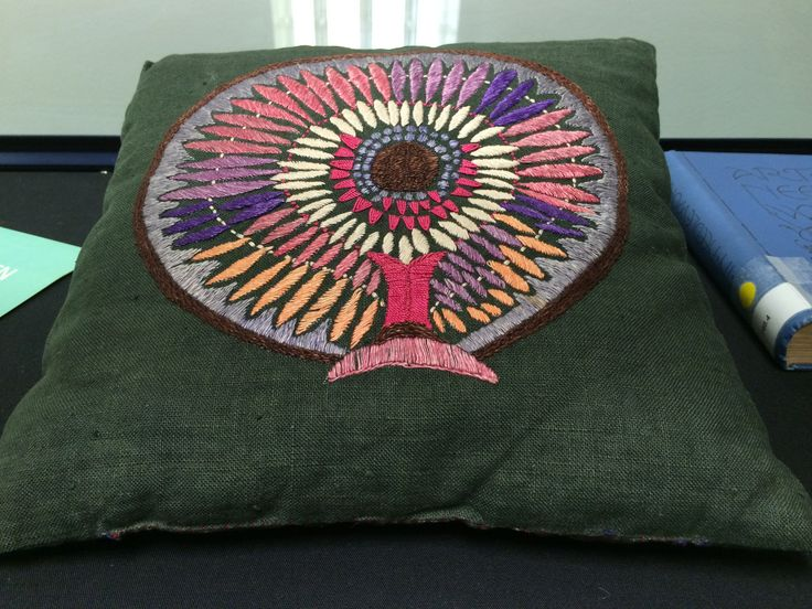 Green embroidered square cushion by Kath Whyte, c1930s-1970s in the GSA Archives and Collections (reference: DC/29/7/13)