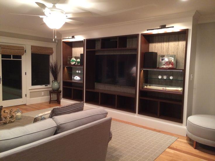 custom wall unit to house sports memorabilia and television designed by ekizian design edit