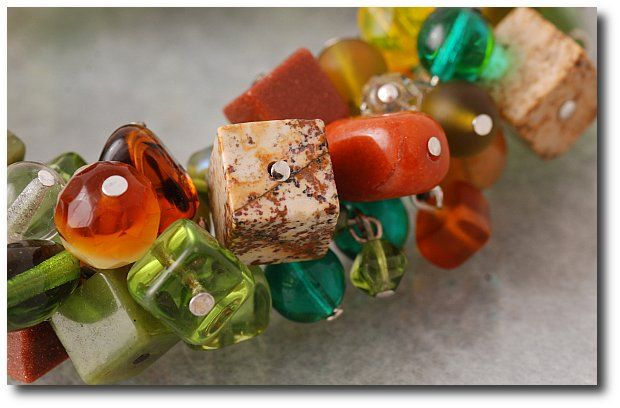 Exclusive bracelet  made of glass in variety shapes and vivid colours.  Photographer: Kozik Magdalena