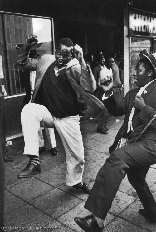 Ian Berry - Dancing in the street, Johannesburg, South Africa, 1961. S)