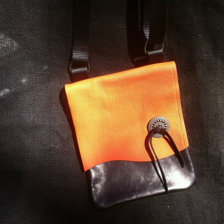 Leather Sling Bag, orange and turquoise front and red back with silver concho, adjustable strap, small pocket inside for phone or keys. Meausures 18cm Wide and 24cm Height.