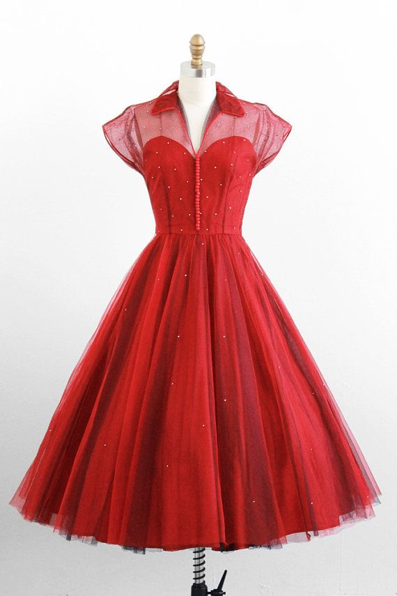Sheer tulle shirtdress over a red sweetheart-necked lining.  With loads of buttons down the front and rhinestones sprinkled all over, this dress is pretty nice. #1950s #fashion