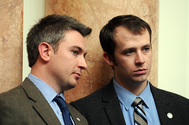 (Left) Representative Ryan Quarles, R-Georgetown (62nd District) and Representative Jonathan Shell, R-Lancaster (36th District) listen to a presentation on the floor of the Kentucky House of Representatives on Friday, January 11. Quarles and Shell are two of three House Representatives under the age of 30, all Republicans, and two of eight House legislators under the age of 40. Seven of the eight under 40 members are Republicans.