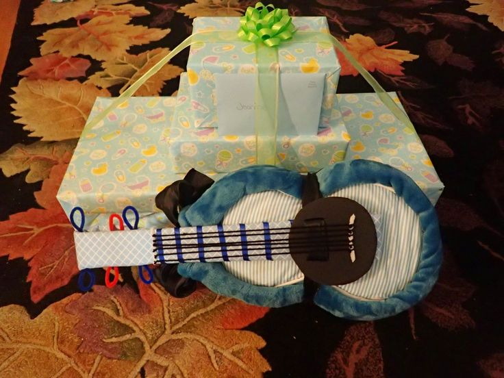Guitar diaper cake for a baby shower gift.