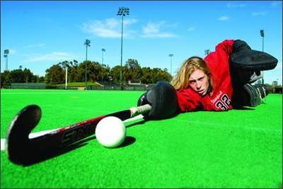 Field Hockey - reaching out for the ball.