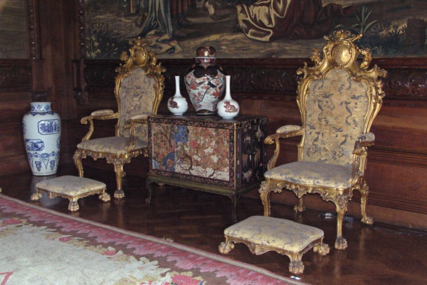 In the State Drawing Room. These two chairs were Coronation thrones of King George III and Queen Charlotte, carved and gilded by Katherine Nash, 1761.