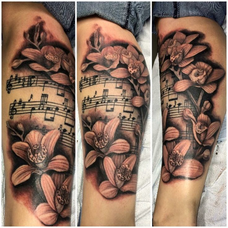 Orchid, sheet music tattoo @ Eye of the Needle Saskatoon, SK