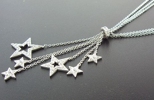 This is a beautiful 925 Sterling Silver necklace with little stars, with simulated diamonds. This is a unique design.