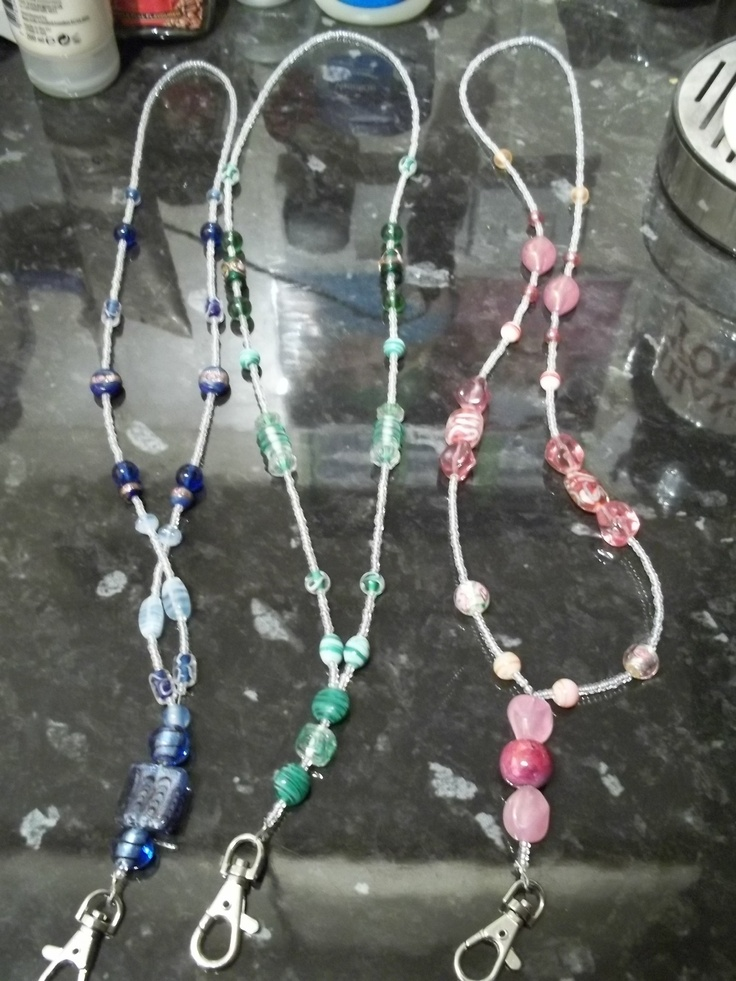 Beaded Lanyards - we can make fabric, beads or whatever and put cards in them with contact info