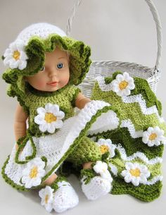 """Original Design by: Maggie Weldon Skill Level: Easy Size: To fit 15"""" Doll Materials: Yarn Needle; ½ Buttons - 2; Sport Weight Yarn; GREEN DRESS: White - 1.75 oz, 160 yd (50 g, 146 m); Light Green (A)"""