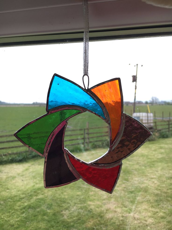 A personal favourite from my Etsy shop https://www.etsy.com/uk/listing/514572206/stained-glass-rainbow-star-suncatcher