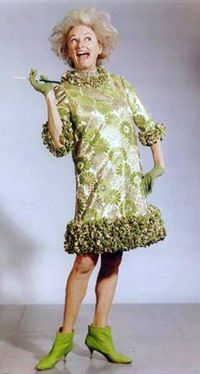 Phyllis Diller in celadon and silver, nicely accented with lime boots. @designerwallace