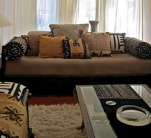 Mud cloth and Kuba cloth pillows via www.designact.com. pretty mix of pillows for downstairs family room on the large sectional.