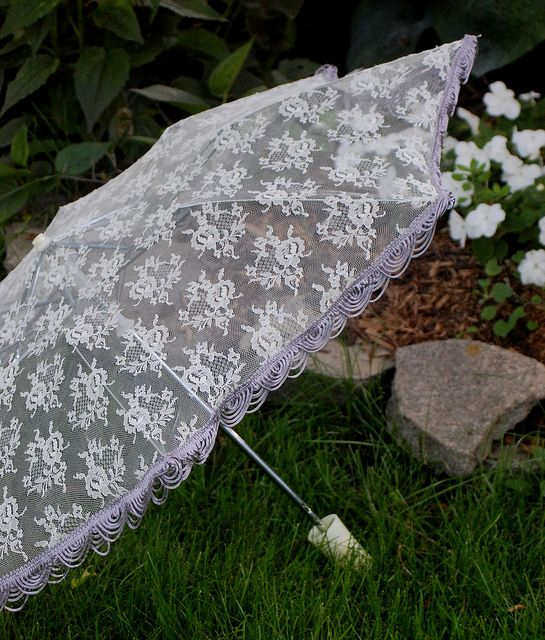 Lace parasol from old umbrella. Don't forget a solid layer underneath