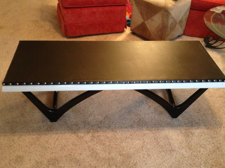 Black and white coffee table with leather/vinyl top and nail head trim