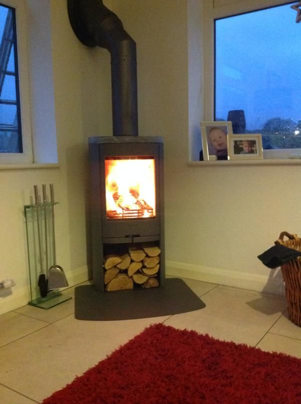Contura 810 is a small Wood burning stove with generous glass area in the door. http://www.contura.eu/English/Stoves/Wood-Burning-Stoves/Stove-Contura-810/