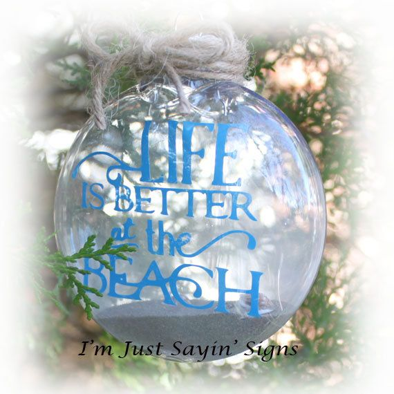 Life Is Better At The Beach Christmas Ornament    Another new addition to our vinyl line. This ornament is for the beach lover. And who doesnt love the beach? I have added vinyl to a 4 flat style acrylic clear Christmas ornament. Sand and some tiny sea shells have been added to the inside of the ornament. Twine has been wrapped around the top of the ornament and also a piece has been attached for hanging.    Shipping will be reduced for an order of 3 or more. Convo for a shipping quote.