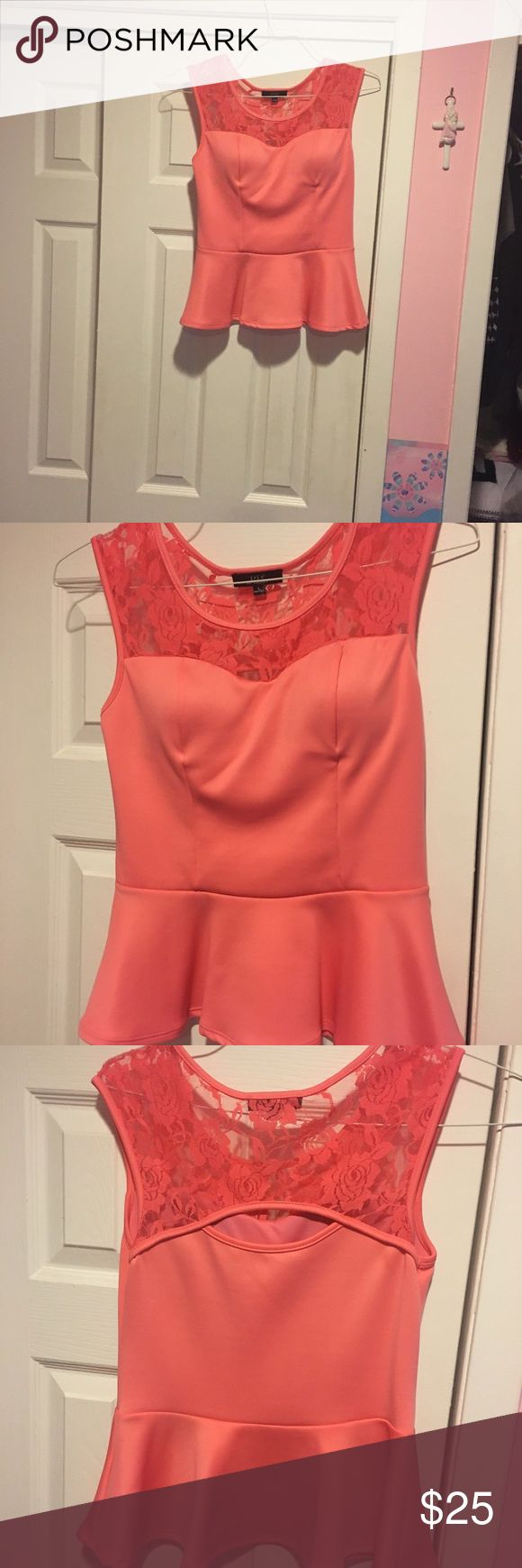 Iris LA Peplum Top Salmon peplum top with lace sleeves. Cups provide padding. Size large. Tops Blouses