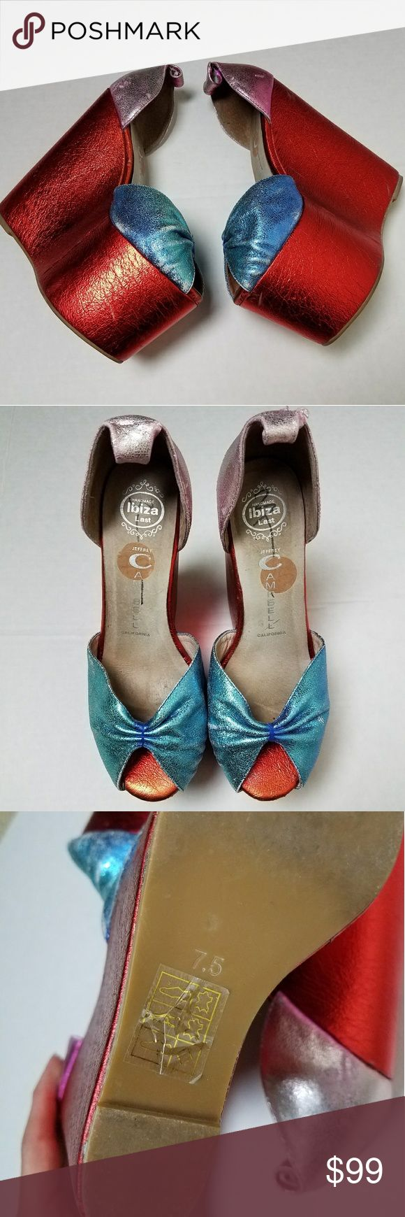 """Candy Foil Jeffrey Campbell Platform Wedge Shoes 7 *Price is being determined*  These shoes are insane!  Super colorful with a bright foil coating in candy apple red and blue upper area. The top heel area is a pink color. These are very previously well - loved and the foil is flaking in several sections. There is also a marking of what looks like a black """"3"""" written in the shoes.  But obviously when your wearing them no one will see this.   The color is also more faded particularly noticable…"""