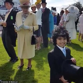 The young boy, who grinned after the gesture, is the young son of an assistant of the Dubai royal family and is often pictured with Sheikh Mohammed's son, Crown Prince Sheikh Hamdan bin Mohammed bin Rashid Al Maktoum