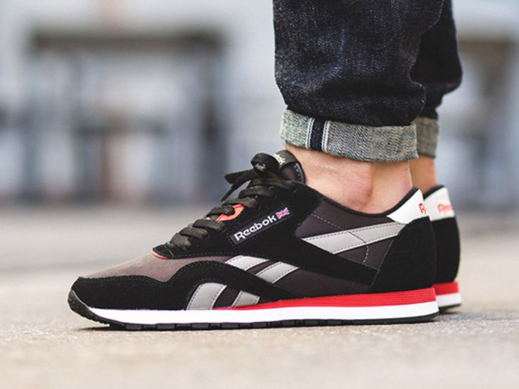 The Reebok Classic Nylon Black Grey Red is the newest release of the retro  runner that features a Black upper with Grey detailing,hints of White and  Red