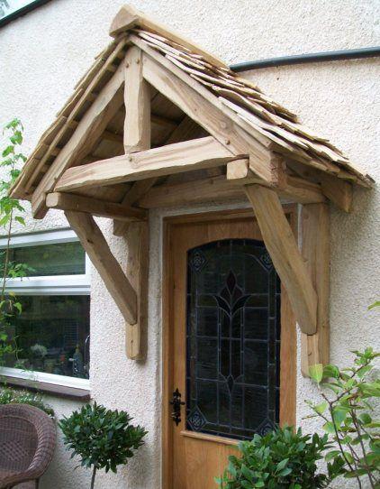 A gallows porch and bespoke oak door