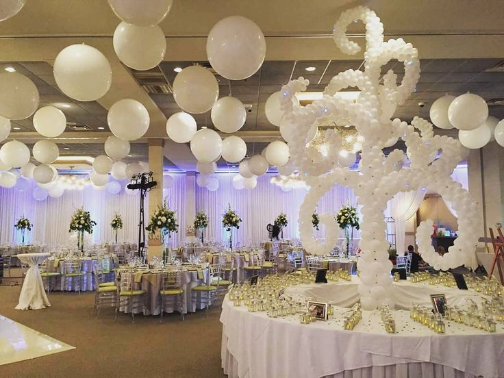 Balloons aren't just for kids! This elegant white balloon wedding should help change your mind. (This was actually our wedding!) | Balloons by Tommy | #balloonsbytommy