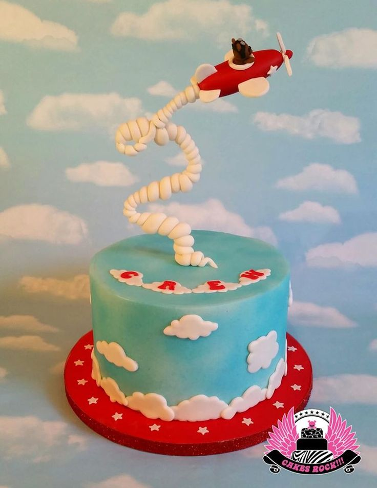 This is the cake I made from Liz's fabulous tutorial!  It was perfect timing, as I had a plane cake due, but they had NO idea I was going to make the topper gravity-defying!  So I had a VERY happily surprised client!