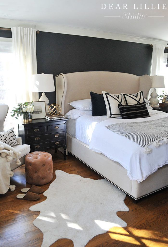 The black velvet pillows from HomeGoods help add a masculine touch to this bedroom with the dark walls. (Sponsored pin)