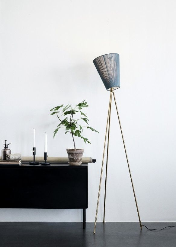 Set the mood for style with Oslo Wood, a trendy floor lamp with a tripod base and multi-directional shade.